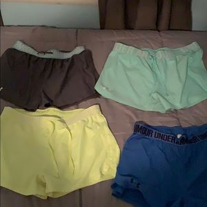 4 pairs of small under armour shorts.